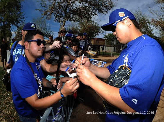 Los Angeles Dodgers Hyun-jin Ryu signs for fans during workout Tuesday, February 23, 2016 at Camelback Ranch-Glendale in Phoenix, Arizona. Photo by Jon SooHoo/©Los Angeles Dodgers,LLC 2016