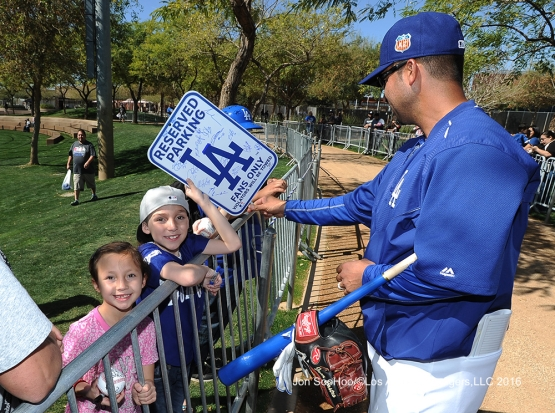 Los Angeles Dodgers Juan Castro signs for fans during workout Wednesday, February 24,2016 at Camelback Ranch-Glendale in Phoenix, Arizona.