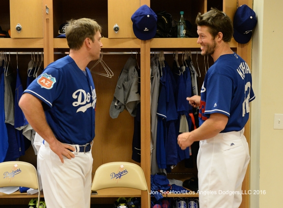 Los Angeles Dodgers A.J. Ellis and Clayton Kershaw speaks prior to workout Wednesday, February 24,2016 at Camelback Ranch-Glendale in Phoenix, Arizona.