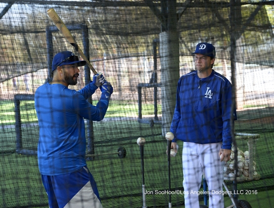 Los Angeles Dodgers Andre Ethier hits off the tee with Assistant Hitting Coach Tim Hyers prior to workout Wednesday, February 24,2016 at Camelback Ranch-Glendale in Phoenix, Arizona.