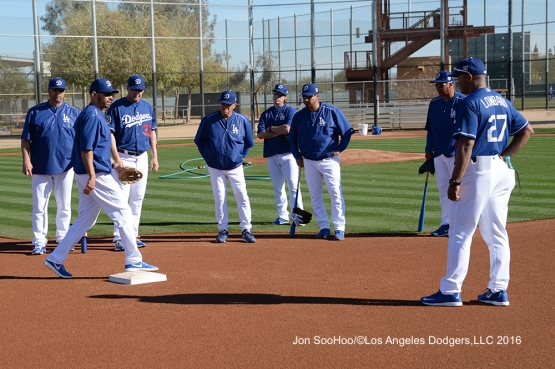 Los Angeles Dodgers Chris Woodward(L) speaks with other coaches during workout Wednesday, February 24,2016 at Camelback Ranch-Glendale in Phoenix, Arizona.