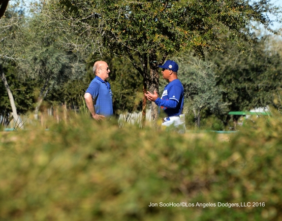Los Angeles Dodgers Stan Kasten and Dave Roberts talk during workout Wednesday, February 24,2016 at Camelback Ranch-Glendale in Phoenix, Arizona.