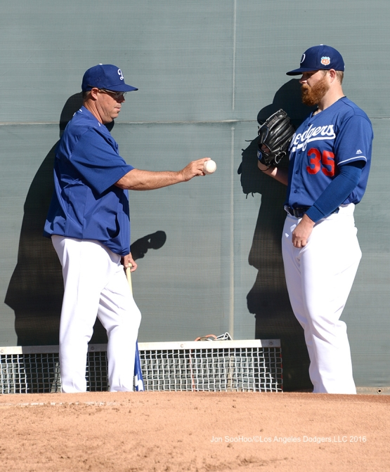 Los Angeles Dodgers Greg Maddux talks with Brett Anderson during workout Wednesday, February 24,2016 at Camelback Ranch-Glendale in Phoenix, Arizona.