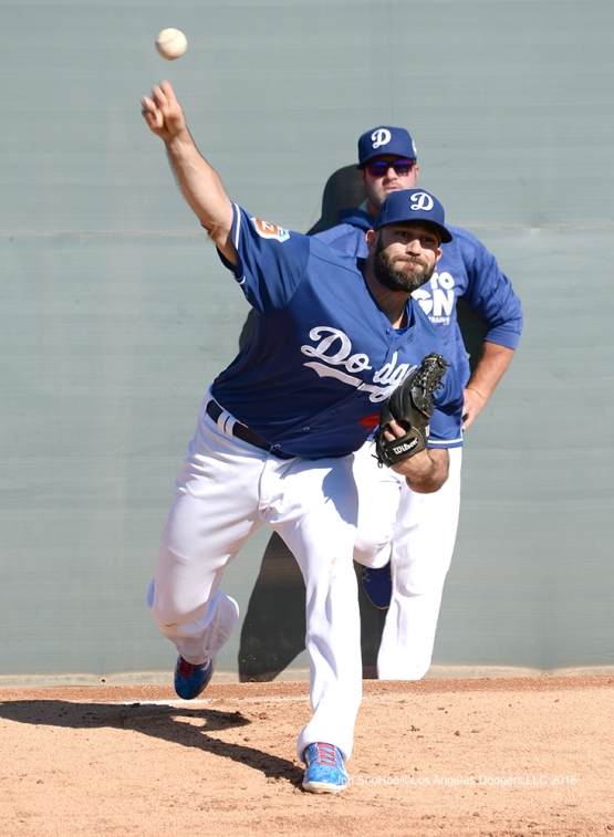Los Angeles Dodgers Chris Hatcher throws during workout Wednesday, February 24,2016 at Camelback Ranch-Glendale in Phoenix, Arizona.