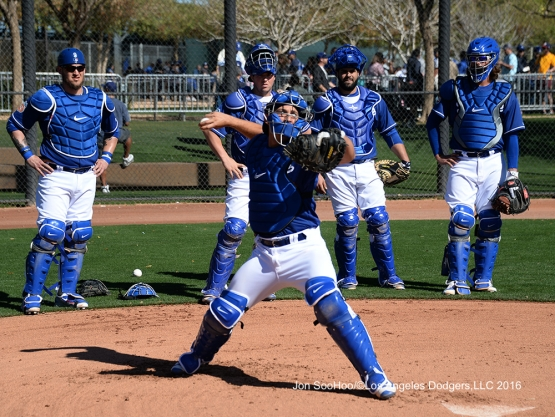 Los Angeles Dodgers Austin Barnes throws to second during workout Wednesday, February 24,2016 at Camelback Ranch-Glendale in Phoenix, Arizona.