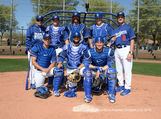 Los Angeles Dodgers catches picture-Top Row (LtoR)-Steve Yeager, Kyle Farmer, Jack Murphy, A.J. Ellis and Bob Geren, Front Row-Austin (LtoR)Barnes, Shawn Zarraga, Yasmani Grandal pose during workout Wednesday, February 24,2016 at Camelback Ranch-Glendale in Phoenix, Arizona.