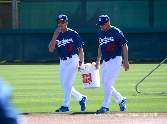 Los Angeles Dodgers coaches Bob Geren and Bill Haselman carry balls in during workout Wednesday, February 24,2016 at Camelback Ranch-Glendale in Phoenix, Arizona.