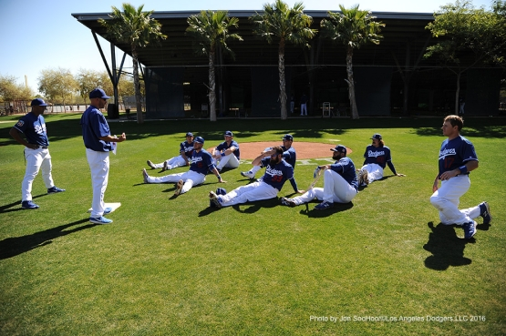 Los Angeles Dodgers base coaches Chris Woodward and George Lombard address players during workout Friday, February 26, 2016 at Camelback Ranch-Glendale in Phoenix, Arizona.