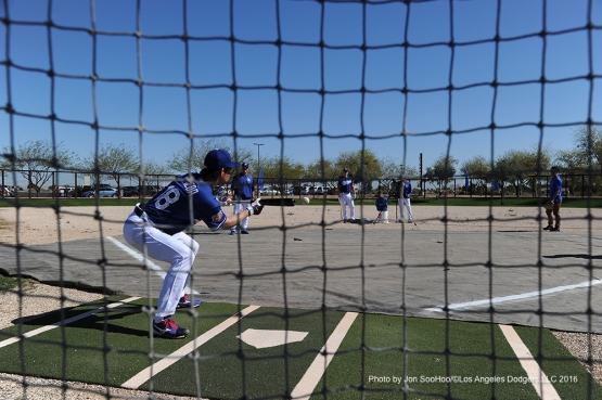 Los Angeles Dodgers Kenta Maeda bunts during workout Friday, February 26, 2016 at Camelback Ranch-Glendale in Phoenix, Arizona.