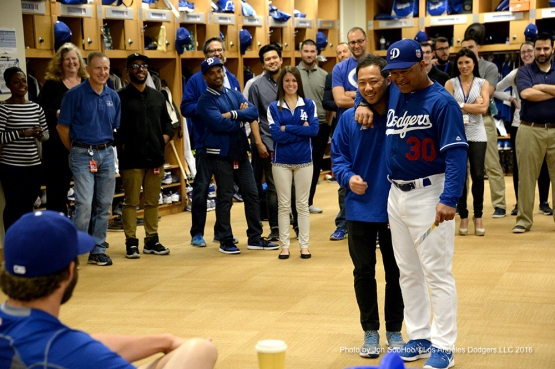 Los Angeles Dodgers manager Dave Roberts introduces Daisuke Sugiura during team meeting Friday, February 26, 2016 at Camelback Ranch-Glendale in Phoenix, Arizona.