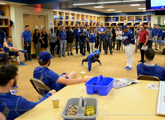 Los Angeles Dodgers manager Dave Roberts has Daisuke Sugiura do a one armed push up during team meeting Friday, February 26, 2016 at Camelback Ranch-Glendale in Phoenix, Arizona.