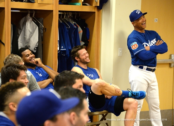 Los Angeles Dodgers Kenley Jansen, Clayton Kershaw and Dave Roberts laugh during the team meeting Friday, February 26, 2016 at Camelback Ranch-Glendale in Phoenix, Arizona.