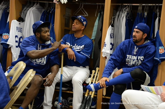 Los Angeles Dodgers Yasiel Puig, Jose Vizcaino and Adrian Gonzalez talk Friday, February 26, 2016 at Camelback Ranch-Glendale in Phoenix, Arizona.