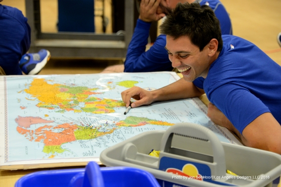 Los Angeles Dodgers Jose De Leon looks over his geography assignment prior to workout Friday, February 26, 2016 at Camelback Ranch-Glendale in Phoenix, Arizona.