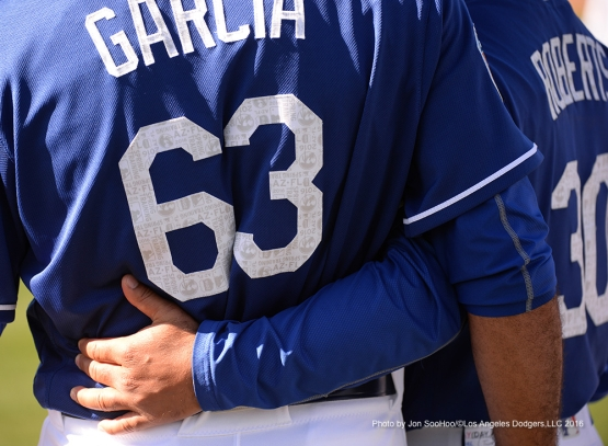 Los Angeles Dodgers Yimi Garcia with arm of Dave Roberts during workout Friday, February 26, 2016 at Camelback Ranch-Glendale in Phoenix, Arizona.