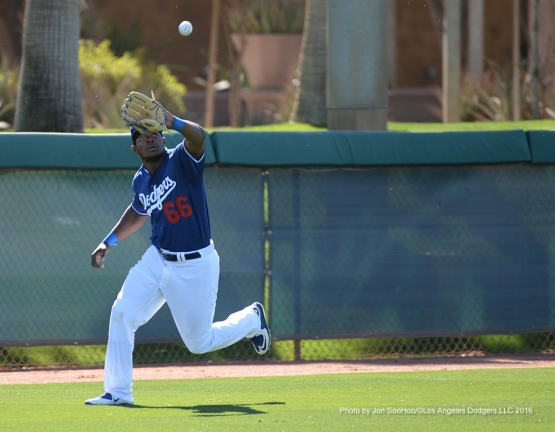 Los Angeles Dodgers Yasiel Puig runs down ball Friday, February 26, 2016 at Camelback Ranch-Glendale in Phoenix, Arizona.
