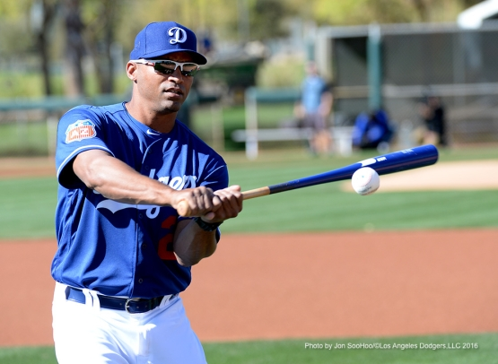 Los Angeles Dodgers George Lombard hits fungus during workout Friday, February 26, 2016 at Camelback Ranch-Glendale in Phoenix, Arizona.