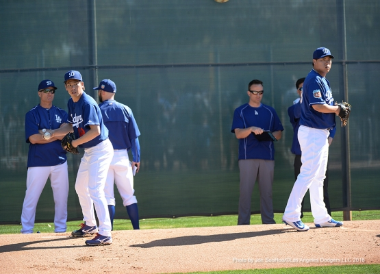 Los Angeles Dodgers Kenta Maeda and Hyun-jin Ryu throw bullpens Friday, February 26, 2016 at Camelback Ranch-Glendale in Phoenix, Arizona.
