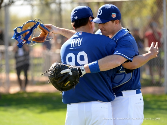 Los Angeles Dodgers Hyun-jin Ryu and A.J. Ellis hug it out during workout Friday, February 26, 2016 at Camelback Ranch-Glendale in Phoenix, Arizona.