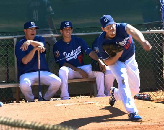 Los Angeles Dodgers Greg Maddux and Jose De Leon watch Clayton Kershaw warm up during workout Saturday, February 27, 2016 at Camelback Ranch-Glendale in Phoenix, Arizona.
