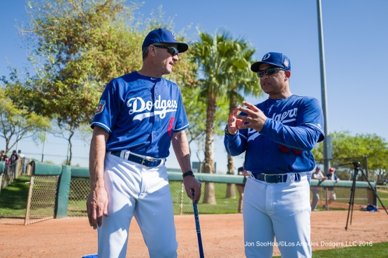 Los Angeles Dodgers Bob Geren and Dave Roberts talk during workout Sunday, February 28, 2016 at Camelback Ranch-Glendale in Phoenix, Arizona.