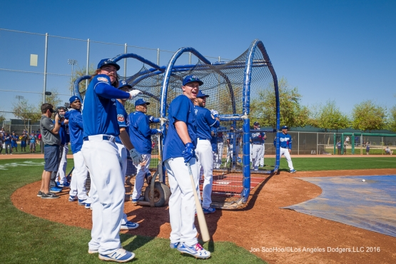 Los Angeles Dodgers Joc Pederson and Jack Murphy watch the ball down the right field line during workout Sunday, February 28, 2016 at Camelback Ranch-Glendale in Phoenix, Arizona.