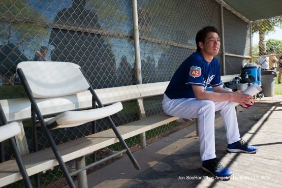 Los Angeles Dodgers Kenta Maeda takes a break during workout Sunday, February 28, 2016 at Camelback Ranch-Glendale in Phoenix, Arizona.
