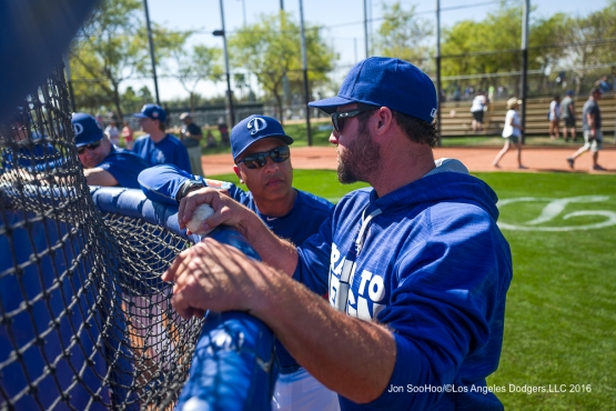 Los Angeles Dodgers Dave Roberts and Eric Gagne talk during workout Sunday, February 28, 2016 at Camelback Ranch-Glendale in Phoenix, Arizona.