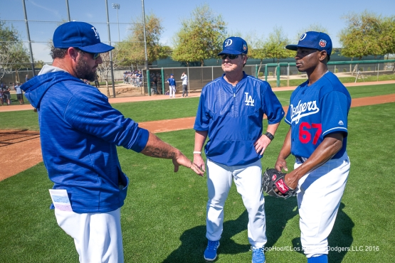 Los Angeles Dodgers Eric Gagne and Rick Honeycutt talk with Jharel Cotton during workout Sunday, February 28, 2016 at Camelback Ranch-Glendale in Phoenix, Arizona.