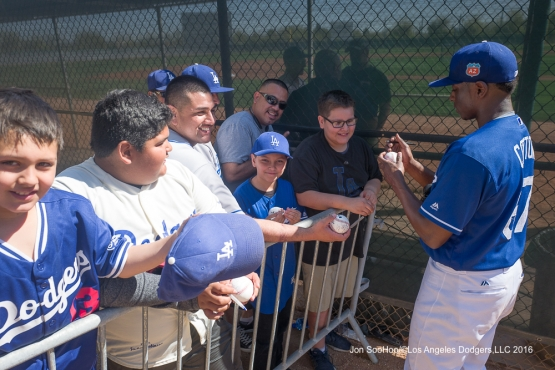 Los Angeles Dodgers Jharel Cotton signs for  fans during workout Sunday, February 28, 2016 at Camelback Ranch-Glendale in Phoenix, Arizona.