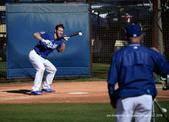 Los Angeles Dodgers Clayton Kershaw bunts with Maury Wills at Maury's Pit during workout Sunday, February 28, 2016 at Camelback Ranch-Glendale in Phoenix, Arizona.