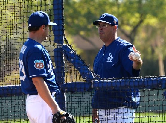 Los Angeles Dodgers Greg Maddux talks with Scot Kazmir during workout Sunday, February 28, 2016 at Camelback Ranch-Glendale in Phoenix, Arizona.