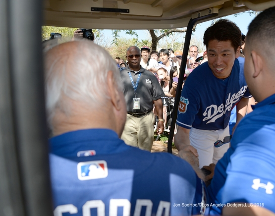 Los Angeles Dodgers Kenta Maeda greets Tommy Lasorda during workout Sunday, February 28, 2016 at Camelback Ranch-Glendale in Phoenix, Arizona.