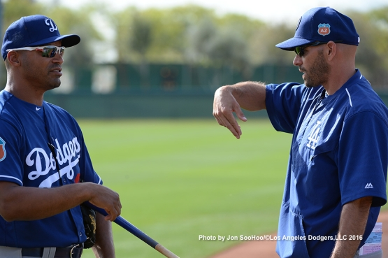 Los Angeles Dodgers George Lombard and Chris Woodward during workout Monday, February 29, 2016 at Camelback Ranch-Glendale in Phoenix, Arizona.