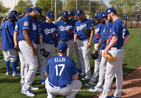 Los Angeles Dodgers A.J. Ellis gives the signs to pitchers  during workout Monday, February 29, 2016 at Camelback Ranch-Glendale in Phoenix, Arizona.