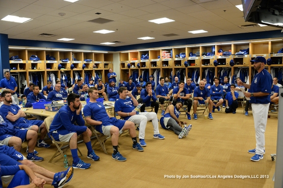 Los Angeles Dodgers coach Chris Woodward speaks to the team during first full squad meetingThursday, February 25, 2016 at Camelback Ranch-Glendale in Phoenix, Arizona.