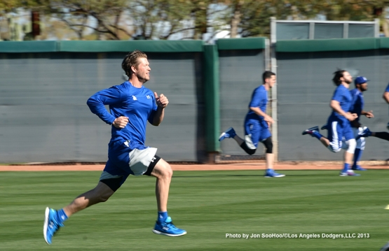 Los Angeles Dodgers Clayton Kershaw runs during first full squad workout Thursday, February 25, 2016 at Camelback Ranch-Glendale in Phoenix, Arizona.