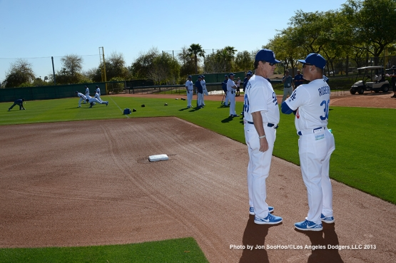 Los Angeles Dodgers Rick Honeycutt and Dave Roberts during first full squad workout Thursday, February 25, 2016 at Camelback Ranch-Glendale in Phoenix, Arizona.