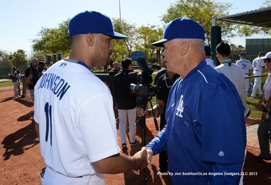 Los Angeles Dodgers Micah Johnson with Maury Wills meet during first full squad workout Thursday, February 25, 2016 at Camelback Ranch-Glendale in Phoenix, Arizona.