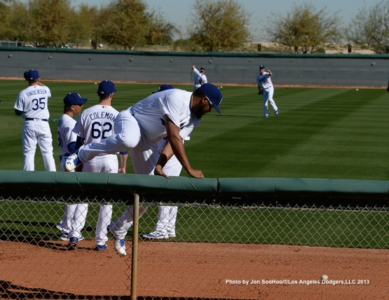 Los Angeles Dodgers Kenley Jansen retrieves ball during first full squad workout Thursday, February 25, 2016 at Camelback Ranch-Glendale in Phoenix, Arizona.