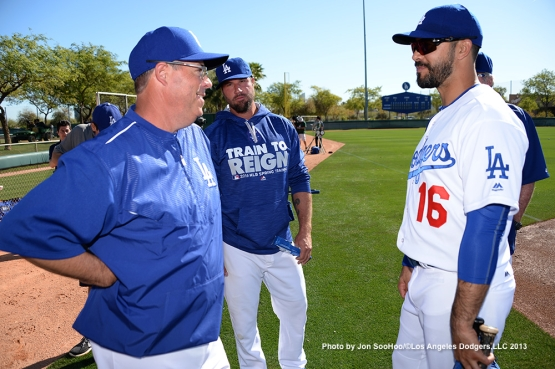 Los Angeles Dodgers Greg Maddux, Eric Gagne and Andre Ethier talk during first full squad workout Thursday, February 25, 2016 at Camelback Ranch-Glendale in Phoenix, Arizona.