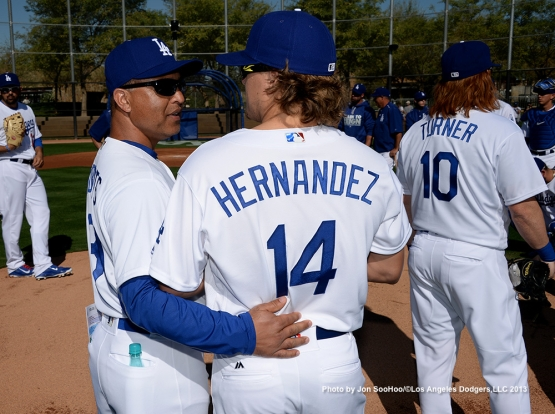Los Angeles Dodgers Dave Roberts and Kike Hernandez during first full squad workout Thursday, February 25, 2016 at Camelback Ranch-Glendale in Phoenix, Arizona.