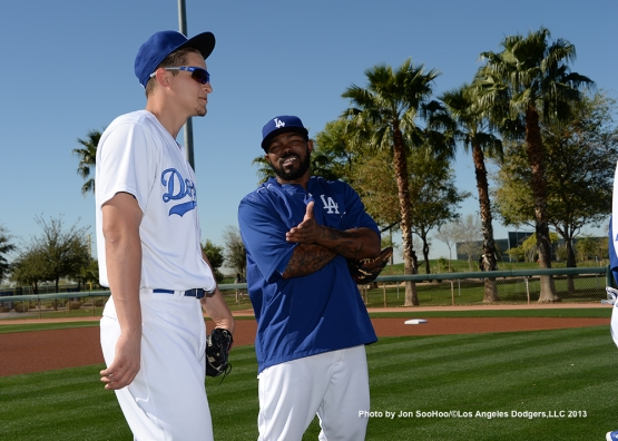 Los Angeles Dodgers Corey Seager and Howie Kendrick talk during first full squad workout Thursday, February 25, 2016 at Camelback Ranch-Glendale in Phoenix, Arizona.