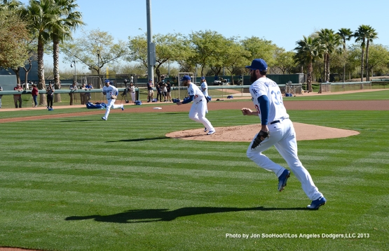 Los Angeles Dodgers Alex Guerrero, Brett Anderson and Scott Van Slyke field ball during the  first full squad workout Thursday, February 25, 2016 at Camelback Ranch-Glendale in Phoenix, Arizona.