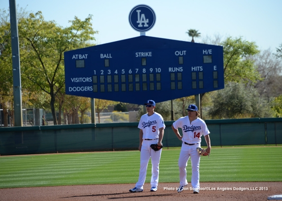 Los Angeles Dodgers Corey Seager and Kike Hernandez wait at shortstop during first full squad workout Thursday, February 25, 2016 at Camelback Ranch-Glendale in Phoenix, Arizona.
