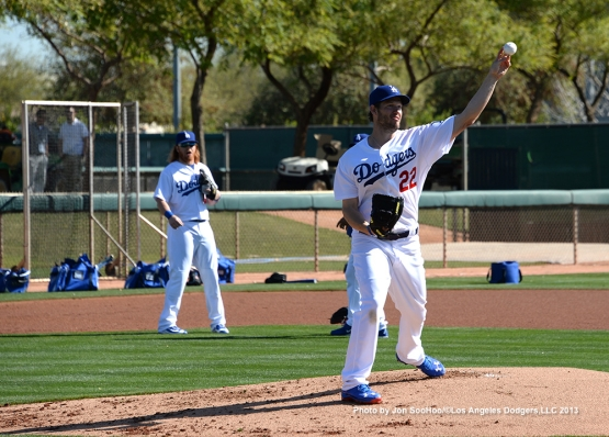 Los Angeles Dodgers Clayton Kershaw throws to first during first full squad workout Thursday, February 25, 2016 at Camelback Ranch-Glendale in Phoenix, Arizona.