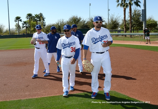 Los Angeles Dodgers Dave Roberts and Adrian Gonzalez walk during first full squad workout Thursday, February 25, 2016 at Camelback Ranch-Glendale in Phoenix, Arizona.
