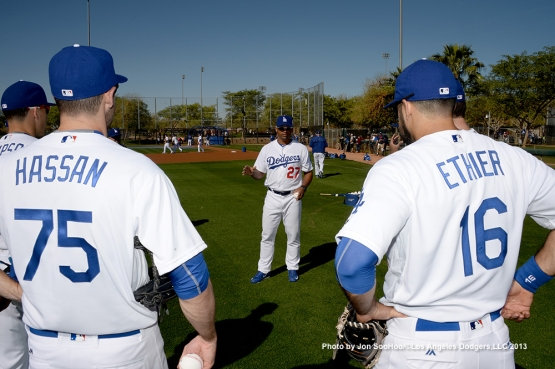 Los Angeles Dodgers coach George Lombard talks to the outfielders during the first full squad workout Thursday, February 25, 2016 at Camelback Ranch-Glendale in Phoenix, Arizona.