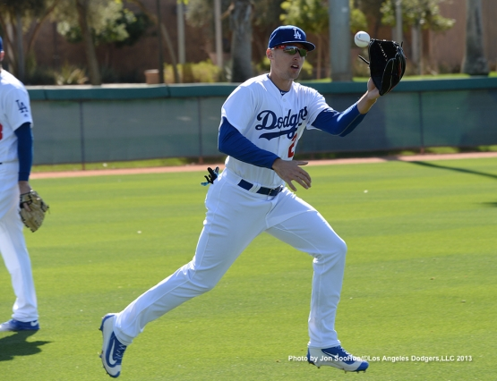 Los Angeles Dodgers Trayce Thompson runs down ball during the first full squad workout Thursday, February 25, 2016 at Camelback Ranch-Glendale in Phoenix, Arizona.