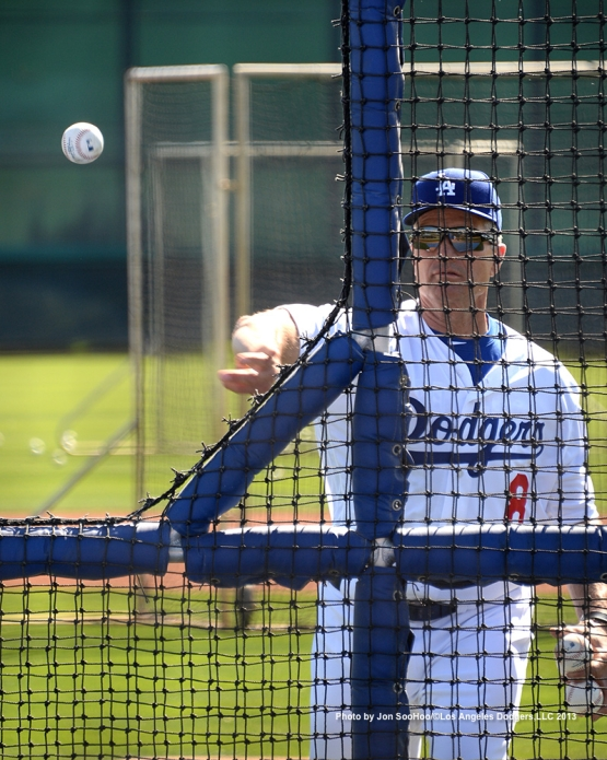 Los Angeles Dodgers bench coach Bob Geren throws batting practice during first full squad workout Thursday, February 25, 2016 at Camelback Ranch-Glendale in Phoenix, Arizona.